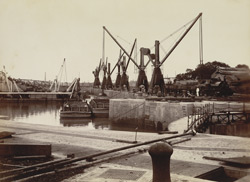 Dredging operations, showing Hydraulic cranes [and] discharging Barges, Calcutta Docks
